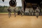 US Aeromedical Evacuation Airmen Exit a C-17 Globemaster Iii