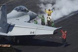 Sailors Prepare an F-A-18F Super Hornet for Launch