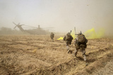 US Marines Sprint across a Field to Load onto a Ch-53E Super Stallion