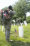 US Army Soldiers Place Flags in Front of the Gravesites in Arlington National Cemetery