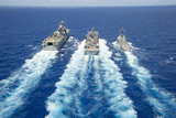 Uss Peleliu and USS Spruance Conduct a Replenishment at Sea with Usns Rainier