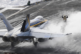 Sailors Prepare an F-A-18C Hornet to Launch from USS Nimitz