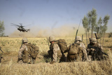 US Marines Watch as Ch-53E Super Stallion Helicopters Land in a Field