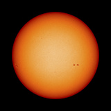 View of the Earth-Facing Surface of the Sun Showing a Few Small Sunspots