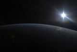 View from Space of the Sun Setting over Earth's Horizon