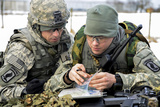 US Army Paratroopers Use a Map to Prepare for a Platoon Exercise