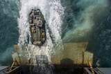 An Amphibious Assault Vehicle Exits the Well Deck of USS Bataan