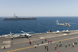 An Mh-60R Sea Hawk Helicopter Launches from USS Harry S Truman