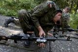 A Polish Soldier Attaches a Training Device to His Pkm Machine Gun