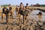 Competitors Emerge from a Mud Pit at Camp Lemonnier  Djibouti