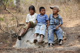 Guatemalan Children Sitting on a Rock in El Robles  Guatemala