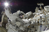 Astronaut Appears to Touch the Bright Sun During a Spacewalk