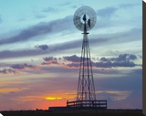 Windmill producing electricity at sunset example of renewable energy  North America