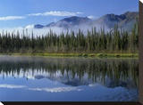 Lake reflecting mountain range and forest  Kluane National Park  Yukon  Canada