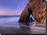 Sea arch and full moon over El Matador State Beach  Malibu  California