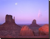 East and West Mittens  buttes at sunrise with full moon  Monument Valley  Arizona