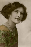 Young Woman in Green Dress and Pearl Necklace