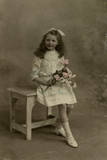 Little Girl with Bunch of Pink Roses