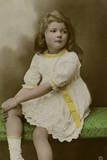 Little Girl in White Dress with Yellow Trimmings