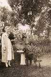 Woman with a Dog in a Garden