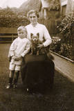 Woman and Boy with a Dog in a Garden