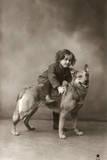 Studio Portrait  Child Sitting on Back of Dog  France