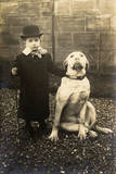Little Boy with Large Bulldog in a Garden  France
