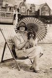 Woman with Dog and Parasol on a Beach