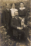 Family of Four and Dog in Garden