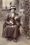 Young Woman with Dog and Cat in Garden