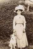 Edwardian Woman with a Terrier in a Garden