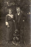Couple and Dog in a Garden