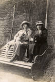 Two Women and their Dogs in a Garden