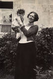 Woman with Pekingese Dog in a Garden