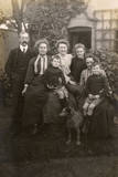 Family of Seven with a Dog in a Garden