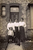 Three Women and a Boy with a Dog