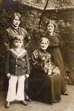 Family of Four with a Dog in a Garden