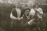 Family Group with Dog in a Garden