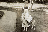 Nanny Taking Baby for a Ride on a Large Dog