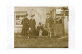 Five People with a Dog in a Garden