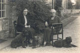 Two Women and Three Dogs in a Garden
