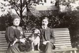 Couple on a Bench with a Dog