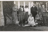 Six People with Two Dogs in a Garden