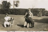 Girl and Boy in Garden with Dogs