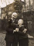 Man and Boy Holding a Dachshund