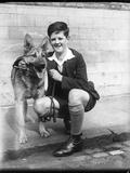 Boy and German Shepherd