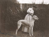 Woman with a Great Dane in a Garden