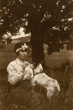 Young Woman and Dog in Field