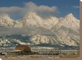 A View of the Mormon Row Barn and the Grand Tetons Behind