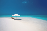 Two Deck Chairs and Beach Umbrella on Tropical Bea